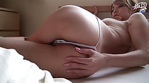 Lying on her side on bed hand on ass
