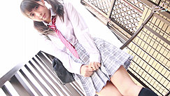 Hands Clasped Together Over Her Skirt Hair In Pigtails Wearing Tie And Shirt