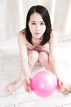 Sitting on floor holding ball