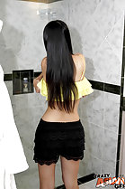 Undressing in bathroom long hair down her back