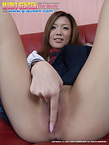 Sitting on couch legs spread finger between shaved pussy lips