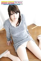 Seated on wood floor legs parted sweater pulled up over her panties
