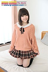 Kneeling On Bed Playing With The Hem Of Her Plaid Short Skirt Short Hair In Orange Sweater