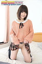 Kneeling On Bed Covers Short Hair Framing Her Sweetness In Sweater Hands Raising The Hem Of Her Short Skirt Showing Off Her Shaved Pussy