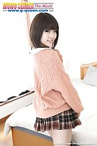 Yuri Hyuga standing beside bed looking over her shoulder short hair orange sweater wearing plaid short skirt