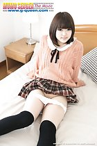 Sitting on bed short hair frames her cute face orange sweater plaid skirt panties pulled down in knee high socks