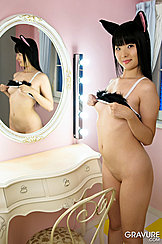 Standing Bottomless In Front Of Dressing Table Mirror Raising Bra Over Small Breasts Shaved Pussy