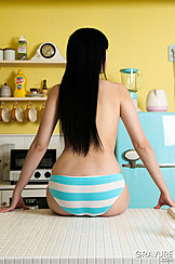 Seated On Worktop Long Hair Down Her Back In Striped Panties