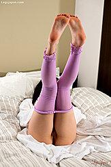 Oguri Miku Lying Back On Bed Legs Raised Bare Feet Putting On Pantyhose
