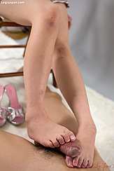 Giving Footjob Between Her Bare Feet