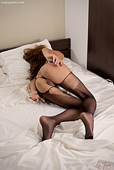 Sugisaki Nanami Lying On Her Side Arms Behind Her On Her Bare Ass Wearing Ripped Pantyhose