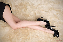 Stretching Her Long Legs In High Heels