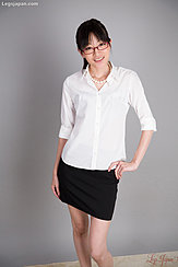 Office Lady Wearing White Shirt In Black Short Skirt Standing With Hand On Hip
