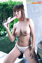Kneeling topless firm big tits sucking head of vibrator wearing panties