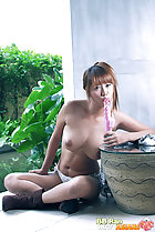 BB Ran sucking head of dildo big breasts legs crossed