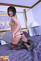 Looking Over Her Shoulder Kneeling Topless Pulling Panties Down Nice Ass Fishnet Stockings High Heels