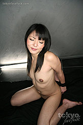 Kozue Maki Kneeling Nude Hands Bound Behind Her Back Long Hair Down Her Chest Small Breasts