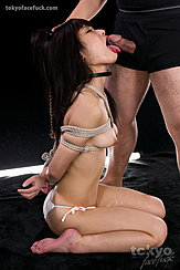 On Her Knees Head Pulled Back By Her Long Hair Licking Cock Arms Tied Behind Her Bare Breasts Projecting Through Rope