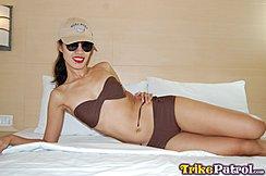 Cindy On Bed In Bikini Wearing Sunglasses