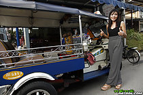 Standing beside tuktuk giving thumbs up