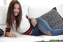 Mint lying on sofa wearing jeans